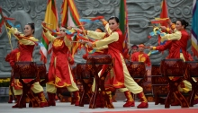 Performers beat drums next to a statue (not pictured) of Vietnam's former emperor Quang Trung during a ceremony marking the 226th anniversary of a celebrated military victory against China, in Hanoi on February 23, 2015.  The ceremony, while remembering when Quang Trung defeated the invading Chinese Qing dynasty's army in 1789, inaugurated a newly built temple (in background) dedicated to the emperor. Nguyen Hue, a native of Bin Dinh who led the victorious Vietnamese forces that day in 1789, was proclaimed Emperor Quang Trung after the battle.     AFP PHOTO / HOANG DINH Nam        (Photo credit should read HOANG DINH NAM/AFP/Getty Images)